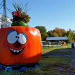 funny orange character made of large hay bale
