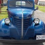 front view of old blue pickup truck
