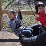 children on tire swing